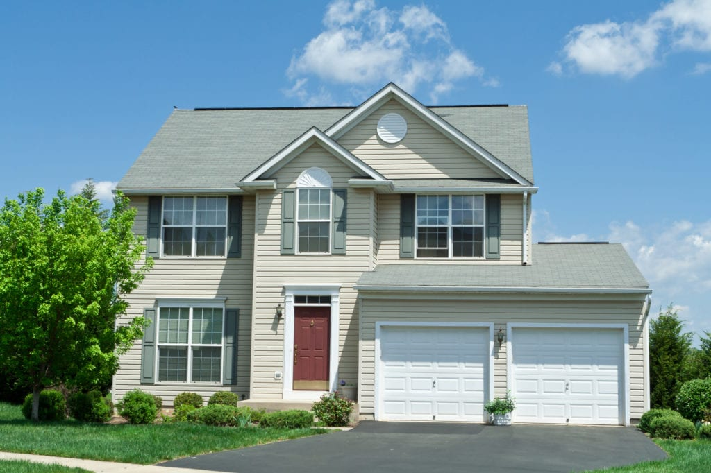 two story home with tan vinyl siding - All Star Construction, Inc.
